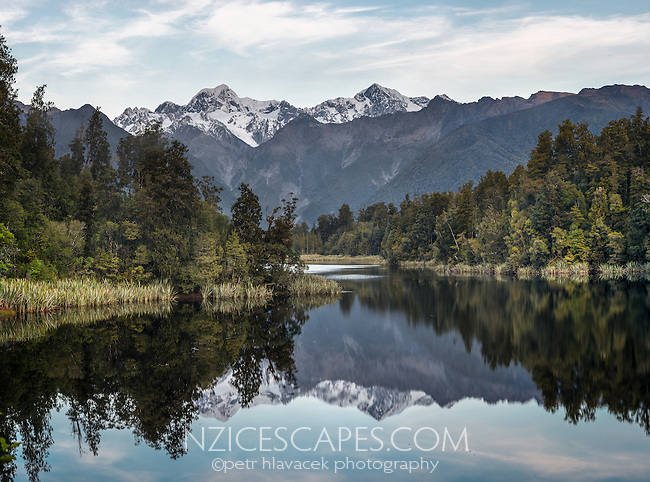 Lake Matheson after sunset with reflections of Aoraki Mt. Cook and Mt. Tasman, Westland National Park, West Coast, UNESCO World Heritage Area, New Zealand, NZ