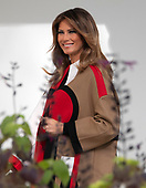 """First lady Melania Trump walks from the White House residence prior to she and United States President Donald J. Trump hosting the National Thanksgiving Turkey Pardoning Ceremony in the Rose Garden of the White House in Washington, DC on Tuesday, November 20, 2018.  According to the White House Historical Association, the ceremony originated in 1863 when US President Abraham Lincoln's granted clemency to a turkey. The tradition jelled in 1989 when US President George HW Bush stated """"But let me assure you, and this fine tom turkey, that he will not end up on anyone's dinner table, not this guy -- he's granted a Presidential pardon as of right now -- and allow him to live out his days on a children's farm not far from here.""""<br /> Credit: Ron Sachs / CNP<br /> (RESTRICTION: NO New York or New Jersey Newspapers or newspapers within a 75 mile radius of New York City)"""