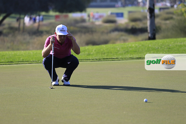 Tyrrell HATTON (ENG) on the 17th green during Pink Friday's Round 2 of the 2015 Omega Dubai Desert Classic held at the Emirates Golf Club, Dubai, UAE.: Picture Eoin Clarke, www.golffile.ie: 1/30/2015