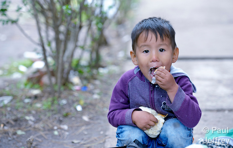Milat, a 4-year old refugee from Afghanistan, enjoys some bread dipped in yogurt in a refugee processing center in the Serbian village of Presevo, not far from the Macedonian border. Hundreds of thousands of refugees and migrants from Syria, Iraq and other countries--including many children--have flowed through Serbia in 2015, on their way to western Europe. <br /> <br /> Parental consent obtained.