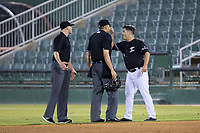 Kannapolis Intimidators manager Justin Jirschele (9) argues a call with base umpire Mike Snover (center) and home plate umpire Emil Jimenez during the game against the Hickory Crawdads at Kannapolis Intimidators Stadium on May 18, 2017 in Kannapolis, North Carolina.  The Crawdads defeated the Intimidators 6-4.  (Brian Westerholt/Four Seam Images)