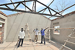 Philip Nyumba, right, inspects construction of a school in the Southern Sudanese village of Mankaro. The school is being constructed by the United Methodist Committee on Relief (UMCOR). Nyumba is the deputy program manager for UMCOR in Southern Sudan. Families here are rebuilding their lives after returning from refuge in Uganda in 2006 following the 2005 Comprehensive Peace Agreement between the north and south. . NOTE: In July 2011, Southern Sudan became the independent country of South Sudan