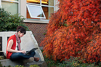 11032010- A Seattle University School of Theology and Ministry student study's on her computer outside Hunthausen on a recent fall afternoon. .