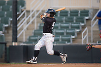 Tyler Sullivan (5) of the Kannapolis Intimidators follows through on his swing against the Greenville Drive at Intimidators Stadium on June 7, 2016 in Kannapolis, North Carolina.  The Drive defeated the Intimidators 5-2 in game two of a double header.  (Brian Westerholt/Four Seam Images)