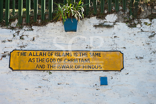 """Shimla, Himachal Pradesh, India. The Toy Train railway sign: """"The Allah of Islam is the same as God of Christians and the Iswar of Hindus."""""""