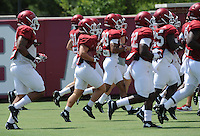 NWA Democrat-Gazette/ANDY SHUPE<br /> Arkansas players warm up Saturday, Aug. 8, 2015. during practice at the university football practice field in Fayetteville.