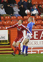 Mak reynolds (left) and Tom Brighton going for the ball in the Aberdeen v Queen of the South William Hill Scottish Cup 5th Round match played at Pittodrie Stadium, Aberdeen on 4.2.12.
