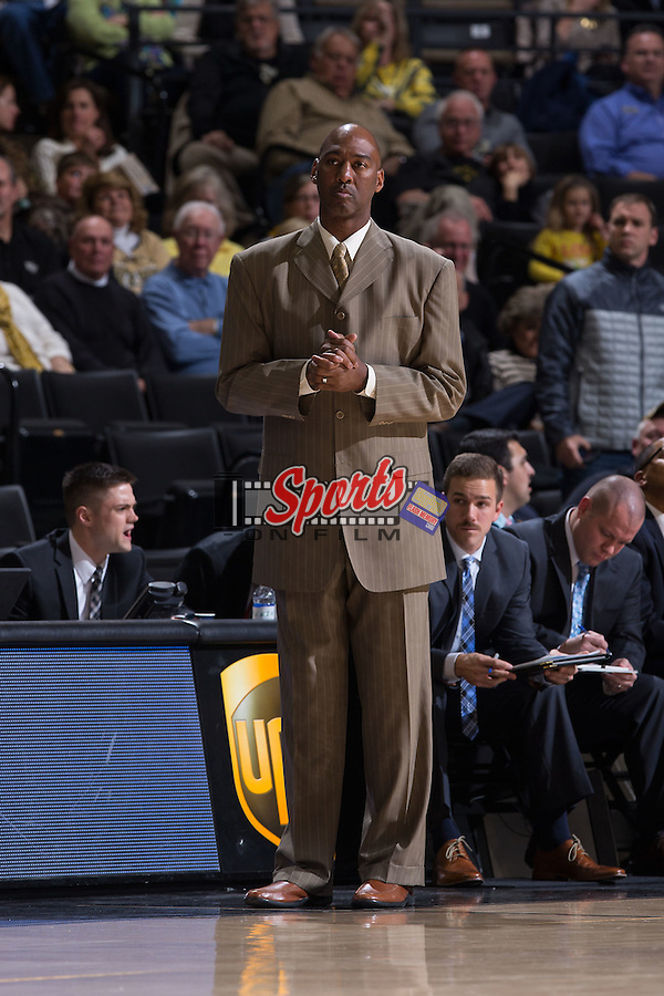 Wake Forest Demon Deacons head coach Danny Manning watches from the sidelines during first half action against the UNC Asheville Bulldogs at the LJVM Coliseum on November 14, 2014 in Winston-Salem, North Carolina.  The Demon Deacons defeated the Bulldogs 80-69  (Brian Westerholt/Sports On Film)