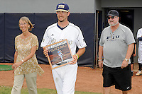 16 May 2010:  FIU's Corey Polizzano (6) and family make their way onto the field prior to the game as FIU honored its seniors.  The FIU Golden Panthers defeated the University of South Alabama Jaguars, 5-0, at University Park Stadium in Miami, Florida.