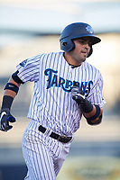 Tampa Tarpons third baseman Angel Aguilar (7) rounds the bases after hitting a home run in the bottom of the third inning during a game against the Daytona Tortugas on April 18, 2018 at George M. Steinbrenner Field in Tampa, Florida.  Tampa defeated Daytona 12-0.  (Mike Janes/Four Seam Images)