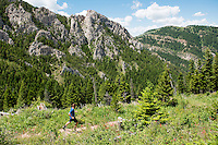 Derek Ivester, of Bozeman, Montana, runs along the Chestnut Mountain trail beneath Frog Rock.