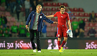 PRAGUE, Czech Republic - September 3, 2014: USA's coach Jurgen Klinsmann and Tomas Rosicky during the international friendly match between the Czech Republic and the USA at Generali Arena.