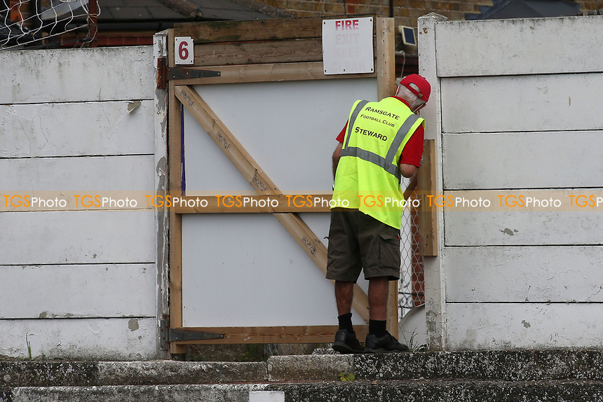 A Ramsgate steward checks to ensure no fans are trying to gain entry into the match during Ramsgate vs Folkestone Invicta, Friendly Match Football at Southwood Stadium on 1st August 2020
