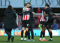 Pontus Jansson of Brentford hugs Henrik Dalsgaard at the final whistle to celebrate their 3-2 victory during Brentford vs Middlesbrough, Sky Bet EFL Championship Football at Griffin Park on 8th February 2020