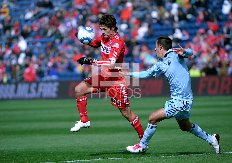 Chicago Fire forward Diego Chaves (99) heads the ball in front of Sporting KC midfielder Davy Arnaud (22).  The Chicago Fire defeated Sporting KC 3-2 at Toyota Park in Bridgeview, IL on March 27, 2011.