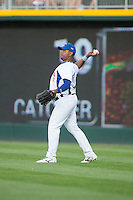 Cuban National Team right fielder Urmany Guerra Vargas (17) throws the ball back to the infield during the game against the US Collegiate National Team at BB&T BallPark on July 4, 2015 in Charlotte, North Carolina.  The United State Collegiate National Team defeated the Cuban National Team 11-1.  (Brian Westerholt/Four Seam Images)