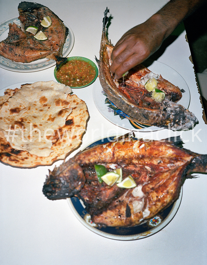 ERITREA, Massawa, a dinner of fresh fish by the Red Sea