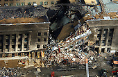 This aerial photograph shot on Friday, September 14, 2001, shows some of the destruction caused when the high-jacked American Airlines flight slammed into the Pentagon in Washington, D.C. on September 11, 2001.  The terrorist attack caused extensive damage to the west face of the building and followed similar attacks on the twin towers of the World Trade Center in New York City.  .Credit: Department of Defense via CNP