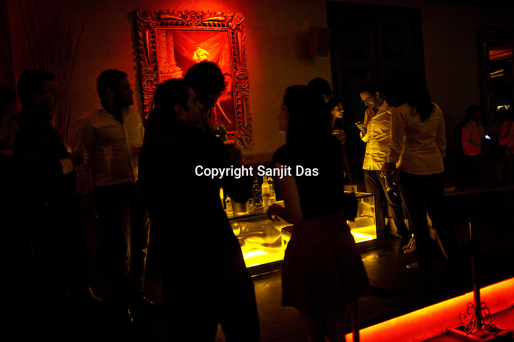 Guest seen on Arjun Rampal's table in The club LAP, founded by Bollywood actor Arjun Rampal and renown Indian restaurateur A.D. Singh, located in Hotel Samrat in New Delhi, India. Photograph: Sanjit Das/Panos