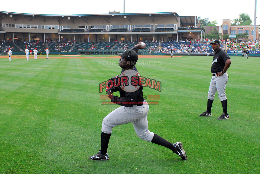 May 27, 2008: Pitching coach Jonathan Hurst, right, who graduated from Spartanburg High, watches  starting pitcher Maikel Cleto begin his warmups during a recent game at Fluor Field in Greenville.Photo by:  Tom Priddy/Four Seam Images