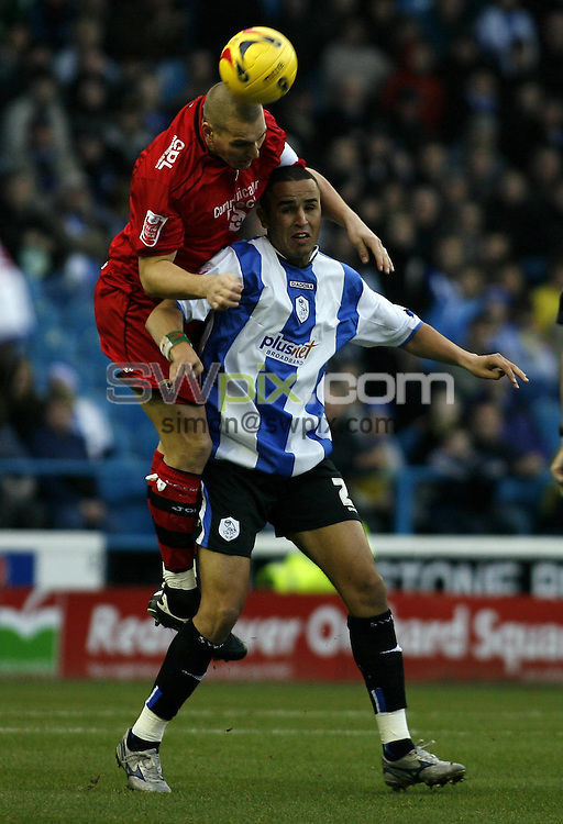 Pix, Shaun Flannery/SWpix. Coca-Cola League Championship. Sheffield Wednesday v Cardiff City, 25.11.06...COPYRIGHT PICTURE>>SIMON WILKINSON>>01943 - 608782>>..Cardiffs Darren Purse beats Wednesday's Madjid Bougherra.