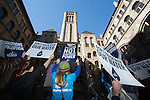 Activists hold signs in front of the County Executive building in Pittsburgh after a group of activists broke from the Powershift march and marched through Pittsburgh. Over six thousand young people from all over the country are converging in Pittsburgh, PA for Power Shift 2013, a massive training dedicated to bringing about a safe planet and a just future for all people. (Photo by: Robert van Waarden)