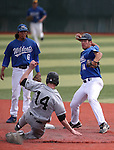 Western Nevada College's Tony Roque watches as Connor Klein gets Mt. Hood runner Jake Azevedo out on a double play at John L. Harvey Field in Carson City, Nev., on Friday, March 14, 2014. <br /> Photo by Cathleen Allison/Nevada Photo Source