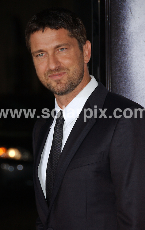 """**ALL ROUND PICTURES FROM SOLARPIX.COM**.**SYNDICATION RIGHTS FOR UK, AUSTRALIA, DENMARK, PORTUGAL, S. AFRICA, SPAIN & DUBAI (U.A.E) ONLY**.Gerard Butler arrives for the Los Angeles premiere of """"Law Abiding Citizen"""". Held at Grauman's Chinese Theater, Hollywood, CA. USA. 6 October 2009.This pic: Gerard Butler..JOB REF: 10079 PHZ Ortega   DATE: 06_10_2009.**MUST CREDIT SOLARPIX.COM OR DOUBLE FEE WILL BE CHARGED**.**MUST NOTIFY SOLARPIX OF ONLINE USAGE**.**CALL US ON: +34 952 811 768 or LOW RATE FROM UK 0844 617 7637**"""