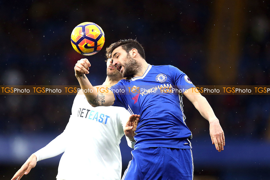 Cesc Fabregas of Chelsea and Fernando Llorente of Swansea City during Chelsea vs Swansea City, Premier League Football at Stamford Bridge on 25th February 2017