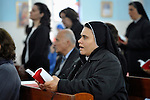 Sister Nabila Saleh, a member of the Congregation of the Rosary, participates in Mass at the Holy Family Catholic Parish in Gaza City. There are only some 3,000 Christians in Gaza, of which just 200 are Catholic..