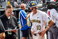Michigan Wolverines third baseman Blake Nelson (10) is interviewed after Game 1 of the NCAA College World Series against the Texas Tech Red Raiders on June 15, 2019 at TD Ameritrade Park in Omaha, Nebraska. Michigan defeated Texas Tech 5-3. (Andrew Woolley/Four Seam Images)