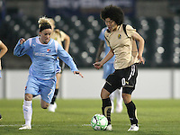 Sky Blue midfielder, Kelly Parker (7) challenges FC Gold Pride striker Eriko Arakawa (10).  Sky Blue FC and FC Gold Pride battled to a 1-1 draw in Bridgewater, NJ on Saturday, April 11, 2009.