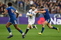 Elliot Daly of England takes on the France defence. Natwest 6 Nations match between France and England on March 10, 2018 at the Stade de France in Paris, France. Photo by: Patrick Khachfe / Onside Images