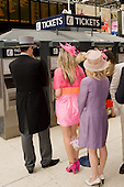 Passengers at Waterloo station buy train tickets to Ascot racecourse.
