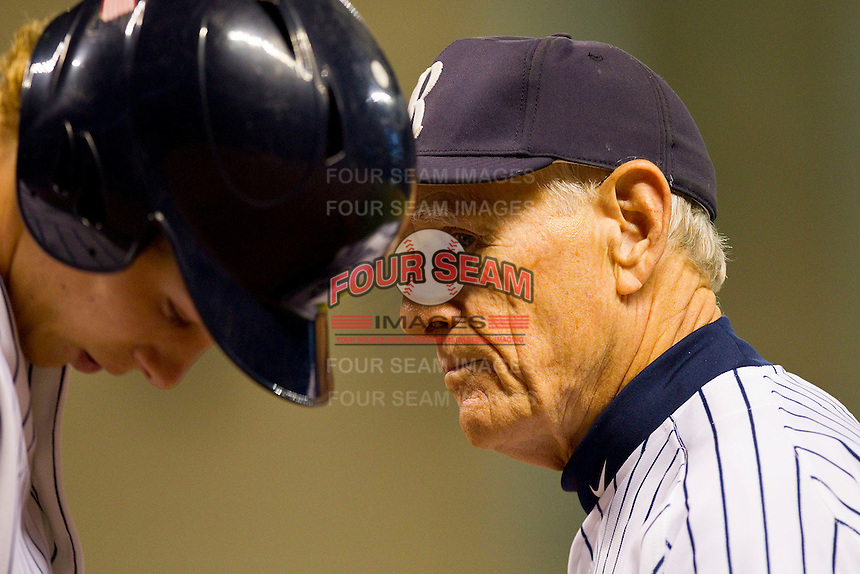 Rice Owls head coach Wayne Graham #37 gives instructions to Jeremy Rathjen #3 during the game against the Texas A&M Aggies at Minute Maid Park on March 5, 2011 in Houston, Texas.  Photo by Brian Westerholt / Four Seam Images