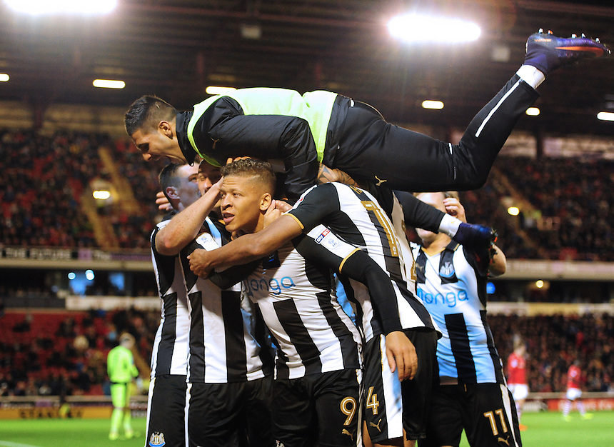 Newcastle United's Dwight Gayle, left, celebrates scoring his sides first goal with team-mates<br /> <br /> Photographer Chris Vaughan/CameraSport<br /> <br /> The EFL Sky Bet Championship - Barnsley v Newcastle United - Tuesday 18th October 2016 - Oakwell Stadium - Barnsley<br /> <br /> World Copyright &copy; 2016 CameraSport. All rights reserved. 43 Linden Ave. Countesthorpe. Leicester. England. LE8 5PG - Tel: +44 (0) 116 277 4147 - admin@camerasport.com - www.camerasport.com