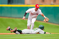 Shortstop Chase Jensen #17 of the Houston Cougars tags out Jake Miller #20 of the Baylor Bears as he tries to get back to second base at Minute Maid Park on March 4, 2011 in Houston, Texas.  Photo by Brian Westerholt / Four Seam Images