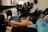 Spectators who want to get into the hearing wait in the hallway for their turn go go into the hearing room as former Trump-Russia special counsel Robert Mueller gives testimony before the United States House Judiciary Committee on the results of his investigation on Capitol Hill in Washington, DC on Wednesday, July 24, 2019.<br /> Credit: Stefani Reynolds / CNP<br /> (RESTRICTION: NO New York or New Jersey Newspapers or newspapers within a 75 mile radius of New York City)
