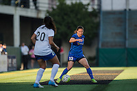 Seattle, Washington - Saturday, July 2nd, 2016: Seattle Reign FC defender Kendall Fletcher (13) looks for a pass during a regular season National Women's Soccer League (NWSL) match between the Seattle Reign FC and the Boston Breakers at Memorial Stadium. Seattle won 2-0.