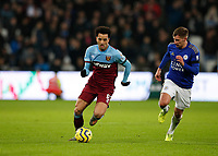28th December 2019; London Stadium, London, England; English Premier League Football, West Ham United versus Leicester City; Felipe Anderson of West Ham United out running Marc Albrighton of Leicester City - Strictly Editorial Use Only. No use with unauthorized audio, video, data, fixture lists, club/league logos or 'live' services. Online in-match use limited to 120 images, no video emulation. No use in betting, games or single club/league/player publications