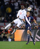 Emile Heskey (21) of England and Steve Cherundolo (6) of USA. USA tied England 1-1 in the 2010 FIFA World Cup at Royal Bafokeng Stadium in Rustenburg, South Africa on June 12, 2010.