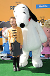 Aubrey Anderson-Emmons and Snoopy arriving at The Peanuts Movie premiere held at the Regency Village Theaters Los Angeles, CA. November 1, 2015
