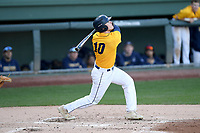 Left fielder Thomas Crowley (10) of the Merrimack Warriors bats in a game against the Michigan State Spartans on Saturday, February 22, 2020, at Fluor Field at the West End in Greenville, South Carolina. Merrimack won, 7-5. (Tom Priddy/Four Seam Images)