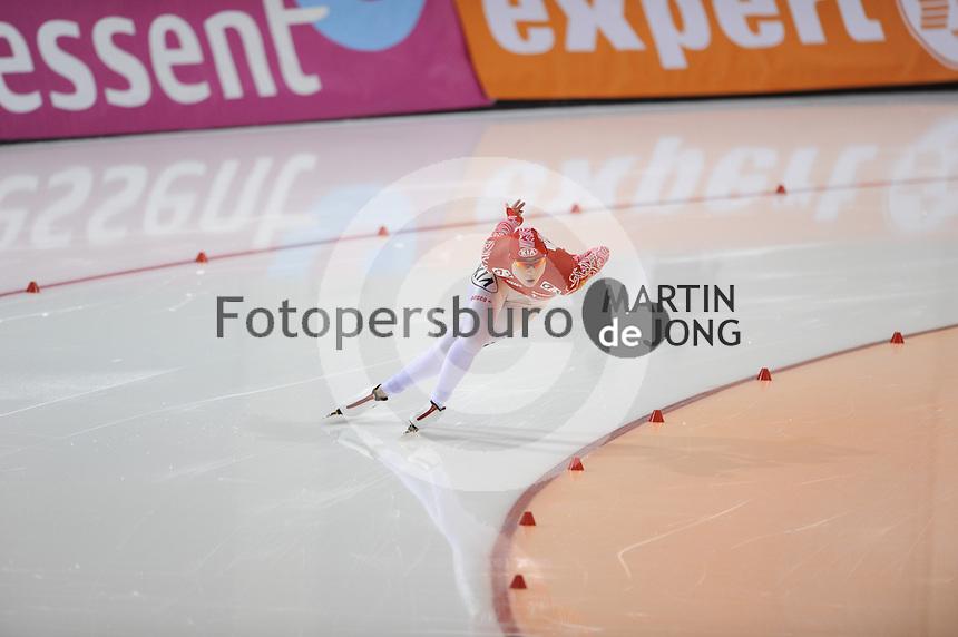 SCHAATSEN: SALT LAKE CITY: Olympic Oval, 27-01-2013, Seizoen 2012-2013, Essent ISU WK sprint, 1000m Ladies, Olga Fatkulina (RUS), ©foto Martin de Jong