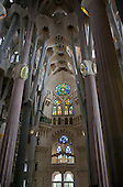 The Basilica de la Sagrada Família (Basilica and Expiatory Church of the Holy Family) showing the ceiling and the branching columns of different heights that support it as well as the stained glass windows in Barcelona, Spain on October 19, 2013.  The columns are designed to create the feeling of a forest.  They form a balanced structure which bears the weight if the vaults, ceilings, and towers.<br /> Credit: Ron Sachs / CNP