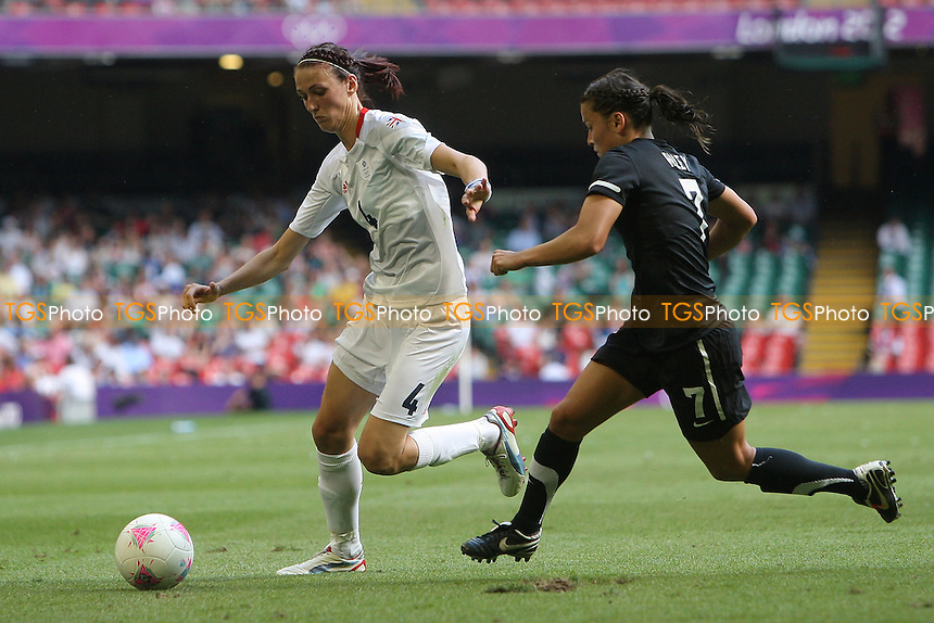 Jill SCOTT of Great Britain takes on Ali RILEY of New Zealand - Great Britain Women vs New Zealand Women - Womens Olympic Football Tournament London 2012 Group E at the Millenium Stadium, Cardiff, Wales - 25/07/12 - MANDATORY CREDIT: Gavin Ellis/SHEKICKS/TGSPHOTO - Self billing applies where appropriate - 0845 094 6026 - contact@tgsphoto.co.uk - NO UNPAID USE.