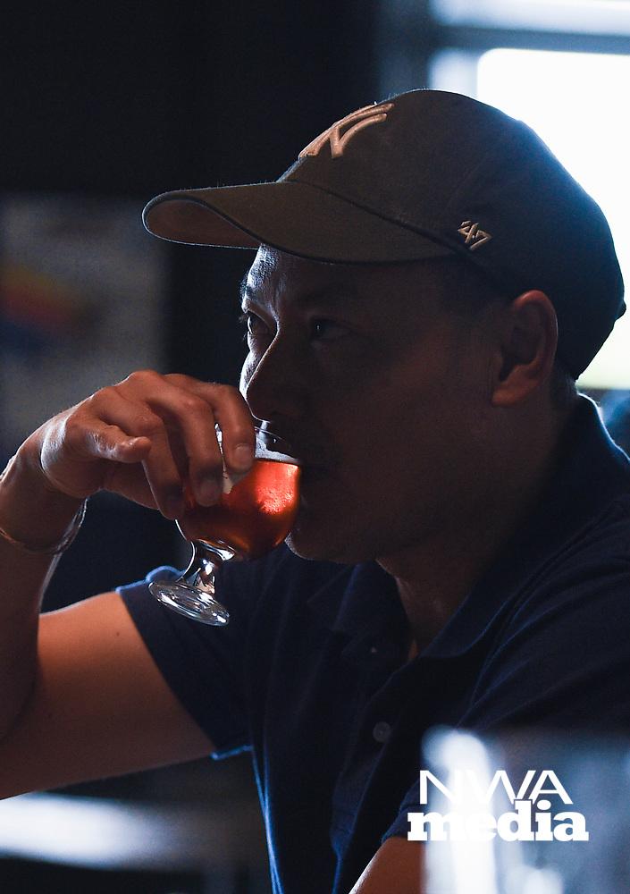 NWA Democrat-Gazette/CHARLIE KAIJO Sonephet Manivong of Grand Island, Neb. drinks a beer, Thursday, August 8, 2019 at the Bike Rack Brewing in Bentonville.<br /> <br /> Bike Rack Brewing is distributing into Little Rock now.