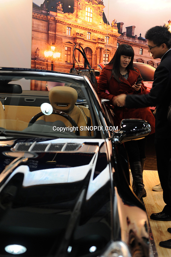 Buyers at the Hangzhou International Luxury Exhibition look at Mercedes for sale at 2 million RMB (190,000 pounds)  in Hangzhou, China 24 Jan 2010.<br /> <br /> PHOTOS BY SINOPIX