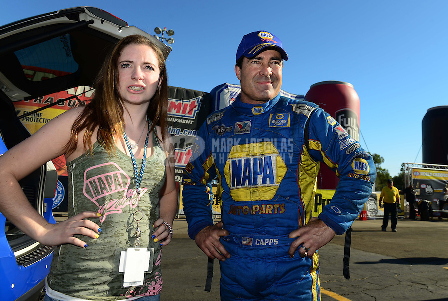 Nov. 11, 2012; Pomona, CA, USA: NHRA funny car driver Ron Capps (right) with his daughter Taylor Capps during the Auto Club Finals at at Auto Club Raceway at Pomona. Mandatory Credit: Mark J. Rebilas-