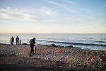 People visit the shore of Lake Baikal at sunset on Saturday, October 19, 2013 in Baikalsk, Russia.